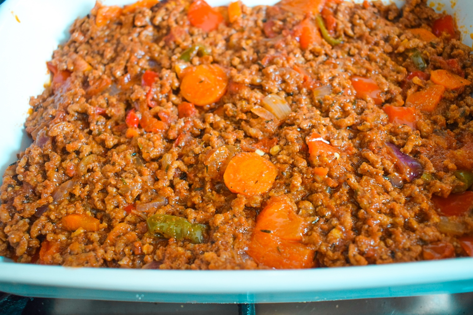 Tomato based beef sauce in casserole dish